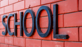 School logo on brick